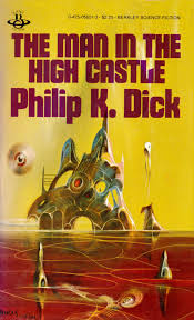 a yellow sky over maroon water/liquid with an imagined structure in the background. The words The Man in the High Castle Philip K. Dick is in the top third of the image.